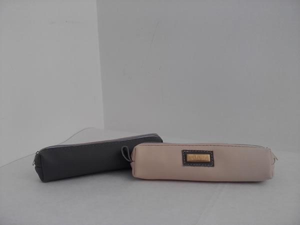 Cartuchera de cuero combinado con detalles artesanales